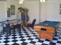 Stylish Games Room with pool table and Air Hockey at our villa  in Orlando near Disney World Resort, Florida